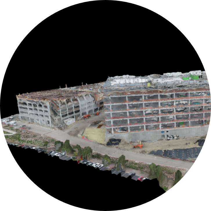 Multiple photos are taken from many angles, allowing a 3d model of the buildings and terrain to be generated